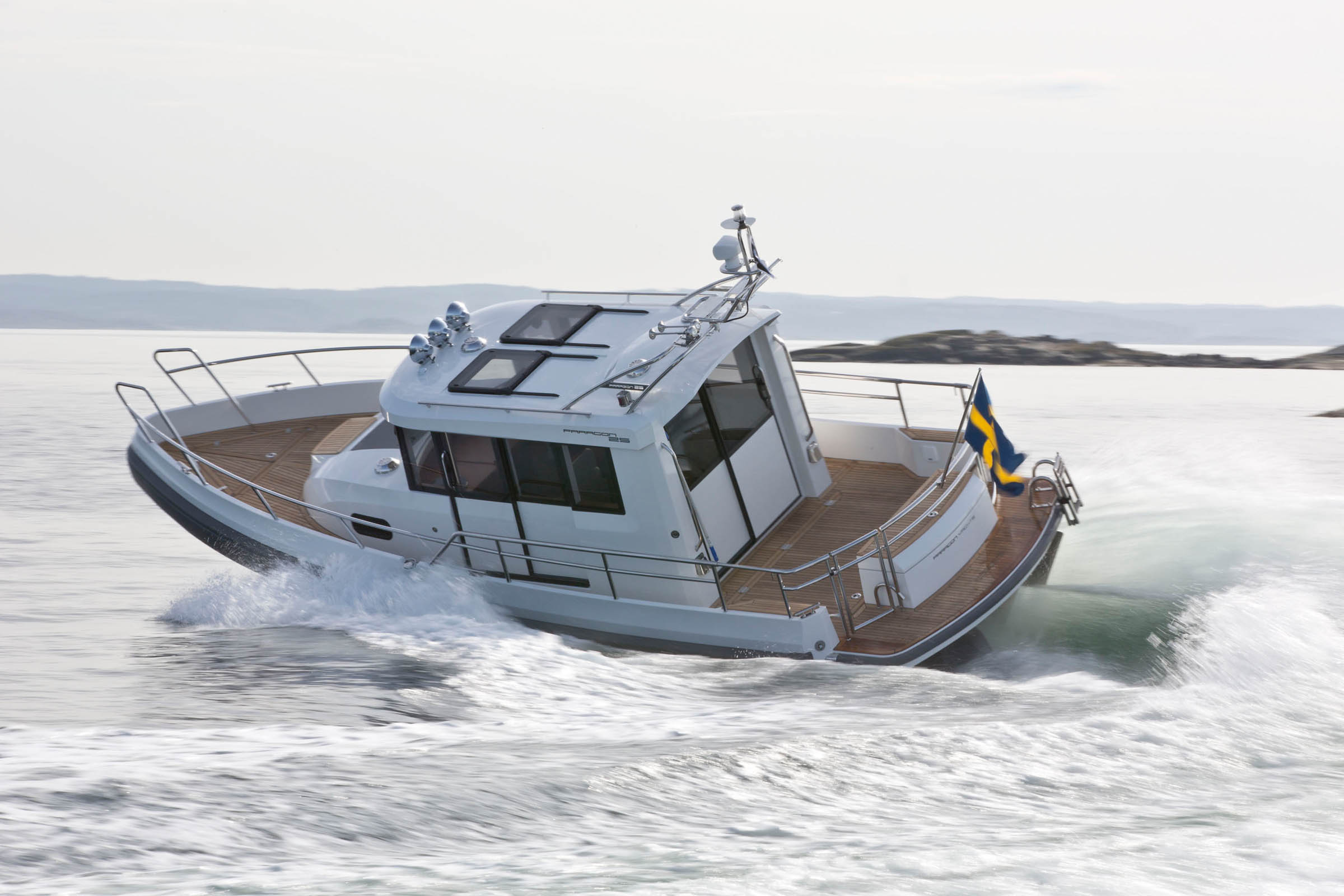 Paragon Boat driving fast on the sea