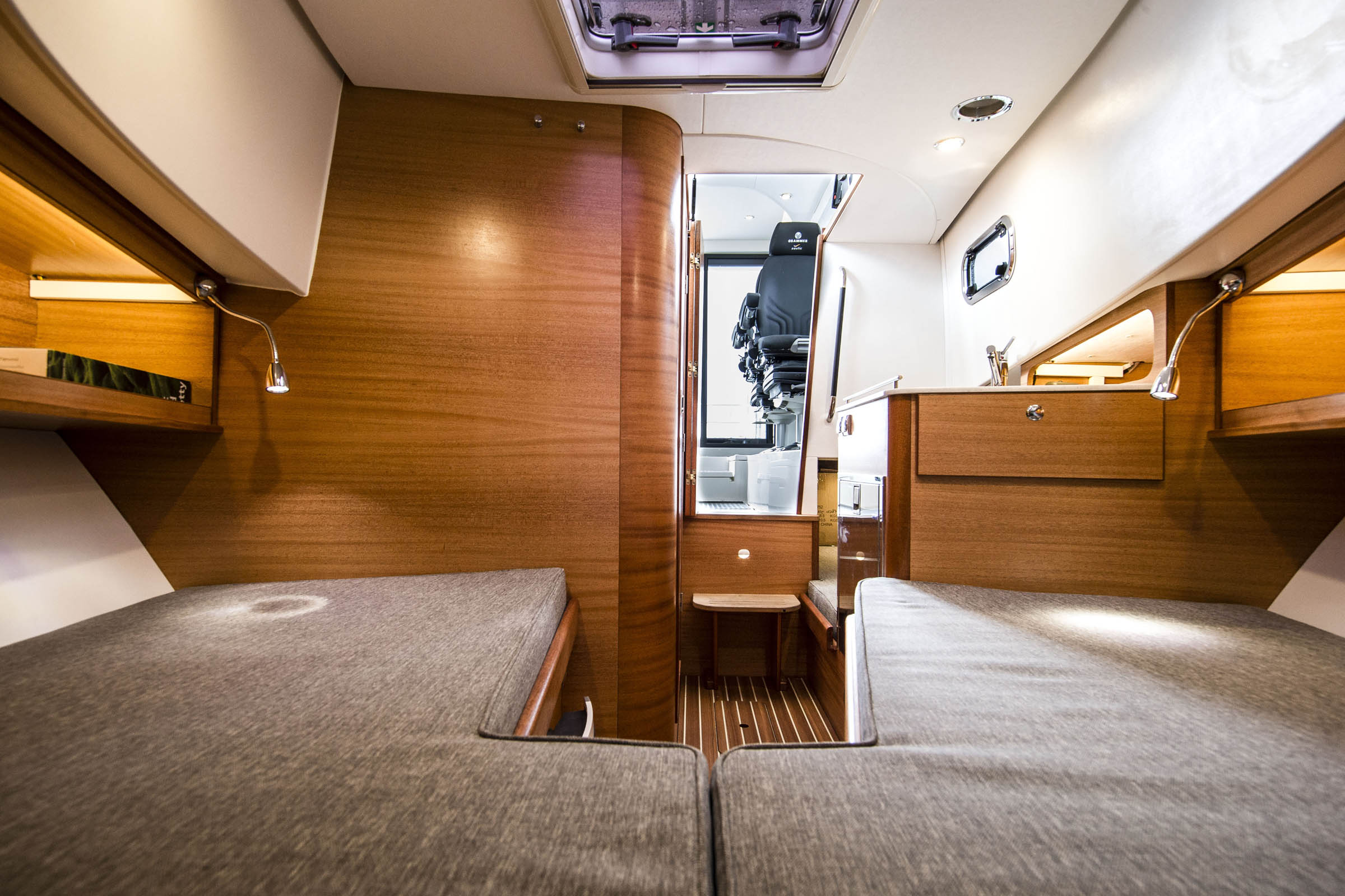 Inside a Paragon Motorboat, two beds and sofas