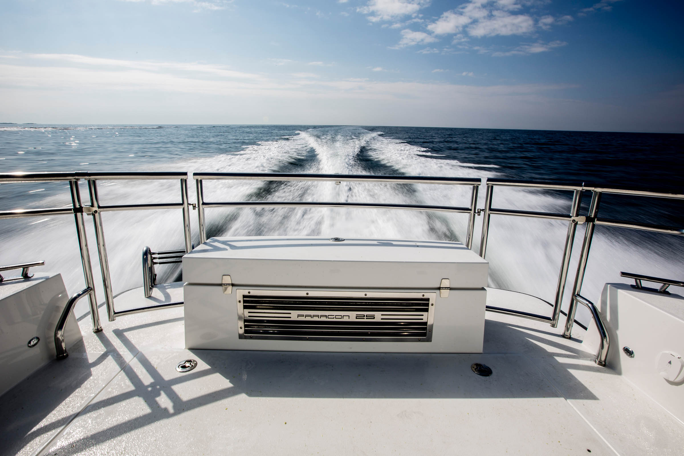 The back of a Paragon 21 which is driving on the sea