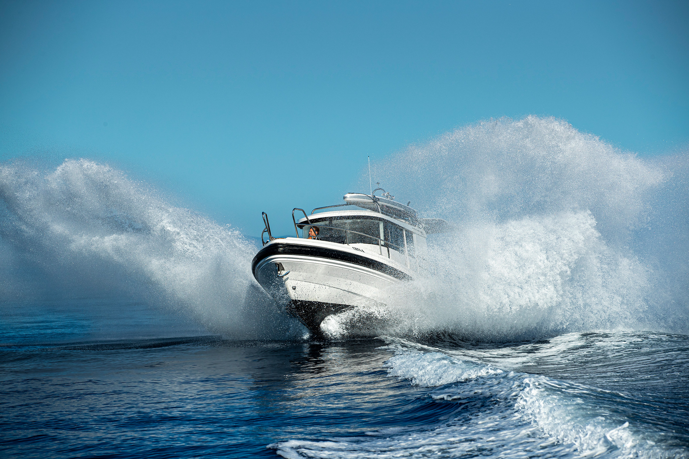 A Paragon 31 Cabin motorboat out on the sea