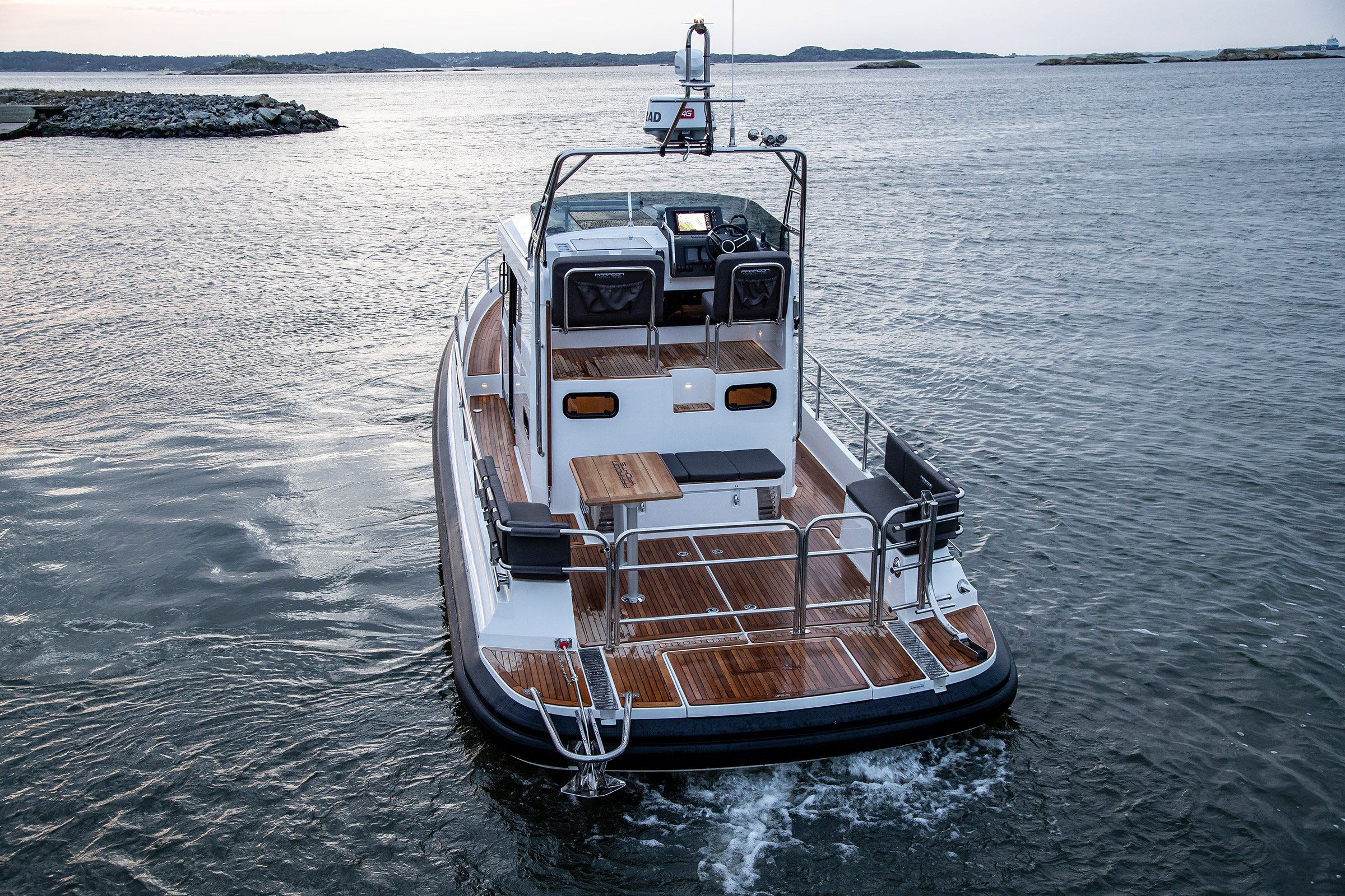 Paragon 31 flybridge, picture taken from the back. On the sea with some small islands around.