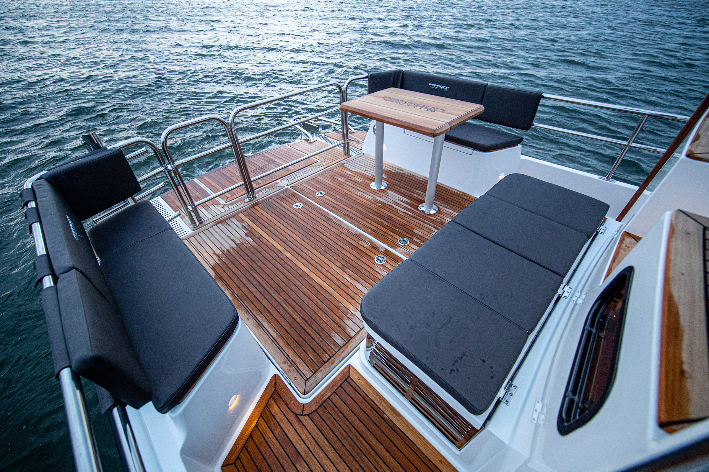 Back of a Paragon 31 Flybridge, a lounge area with a table and seats