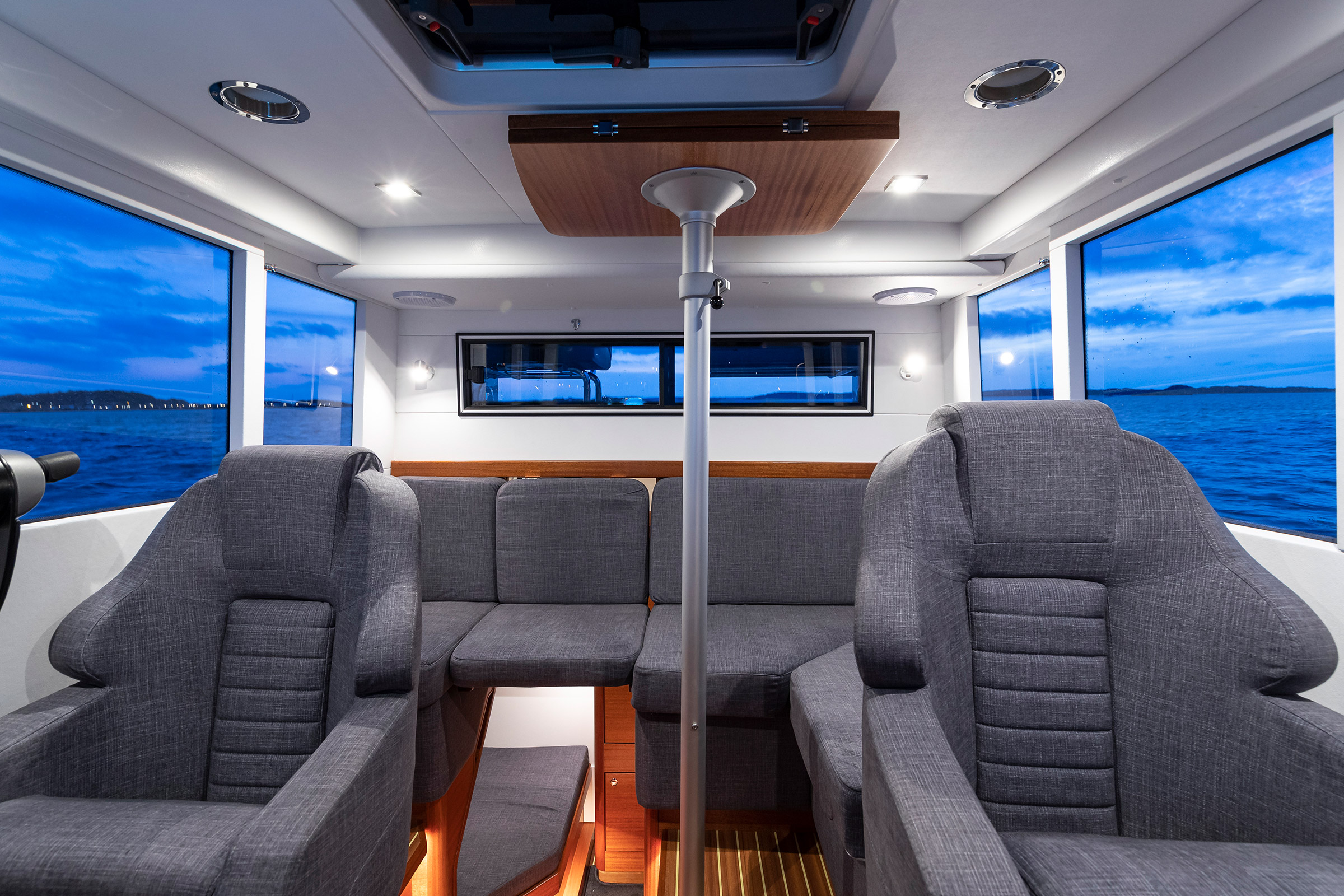 Inside a Paragon 31 Flybridge, 2 chairs and 1 sofa
